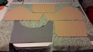 Cutting out sleeves after bodice back got a centered motif