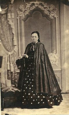 Civil War full length cloak with fitted shoulders and single closure at neck.