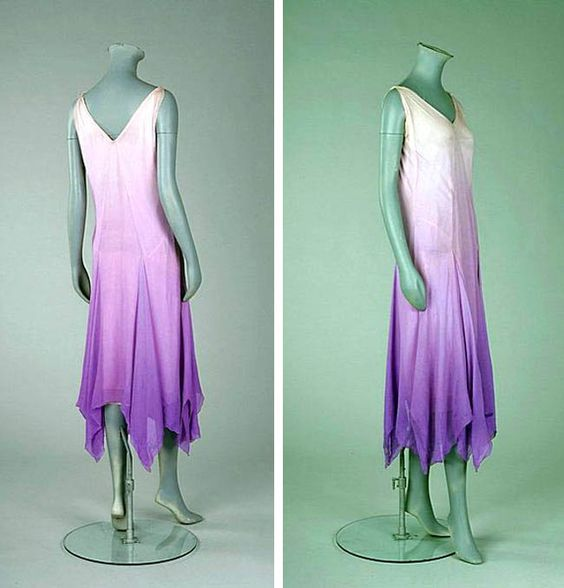 Madeleine Vionnet lilac ombré chiffon bias-cut cocktail gown, ca. 1927. Simple slip-like gown with slightly ruched bodice to either side of the central inset point. Skirt falls in gored handkerchief pleats, the V-neckline and armholes edged with simple silver picot thread, integral petticoat.
