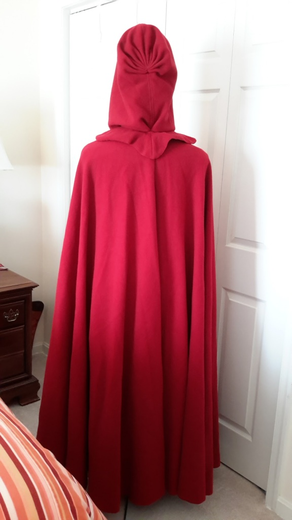 red-cloak-tall-head-back