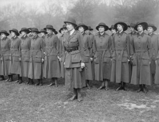 WWI Uniform dress- notice officer has jacket but the rest are shirtwaist dresses.- these are probably wool serge.
